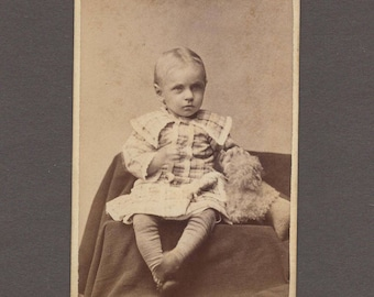 CDV of a Well Dressed Child and Her Fuzzy Stuffed Animal