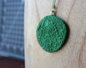 Green patterned polymer clay necklace