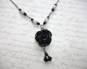 Black flower pendant necklace with pearls