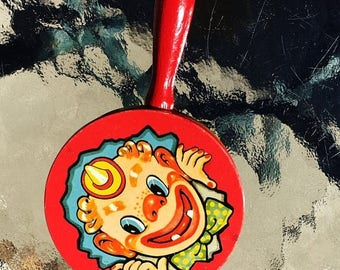 ON SALE - Vintage Clown Yellow and Red Tin Rattle Party Noise Maker Wood Handle Made in USA