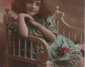 Precocious child, vintage postcard, turquoise dress, frizzy hair, vintage child, sepia portrait, altered art, pink sepia blue  (rppc/ch469)