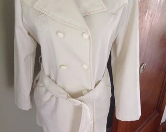 Vintage double breasted jacket.....off white with brown top atitching....wide lapels....belted....excellent condition...epaulet shoulders
