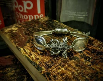 Ornate frog two piece spoon bracelet made of vintage silver plated Silverware with magnetic clasp.