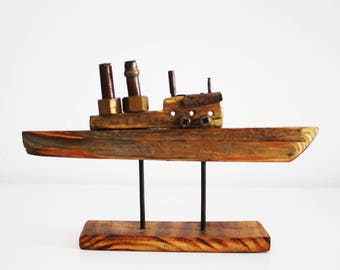 Sculpture steam boat made of recycled wood and metal