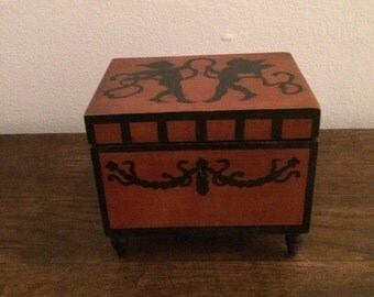 Antique wooden jewelry box.