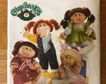 "Butterick 5902 - Cabbage Patch Kids Outfit Collection with Overalls, Shirt, Dress with Sailor Style, Pinafore, and Bunny Pajamas - 16"" Dols"
