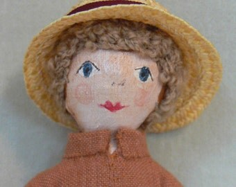 James, a small painted cloth doll