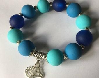 Bracelet blue beads and lotus flower