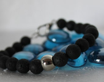 Men's bracelet with lava stone and silver charms