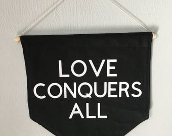 Love conquers all wall banner