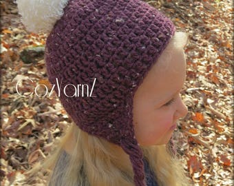 Ear Flap hat, Plum speckled with faux fur poof on top, crochet  handmade, warm & cozy, beanie, pom pom, braided string ties