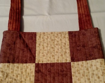 Brown and yellow quilted patchwork bag