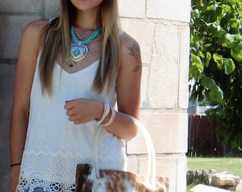Cowhide Tote with a star www.semleatherbags.com