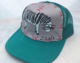 Ryan Merrit Zebra Art Collab - Adult Large Trucker Hat