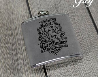 Harry Potter House Flask. Leather Flask. House Crest Flask. Gryffindor. Slytherin. Hufflepuff. Ravenclaw. House Crest Flasks. Pocket Flask.