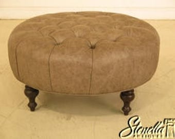 43329E:  Round Tufted Leather Ottoman With Nice Turned Legs