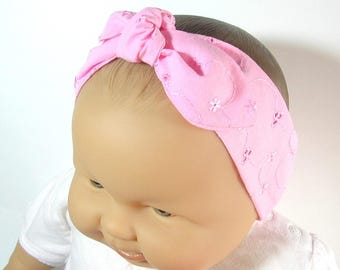 Pink baby headband, white embroidery.
