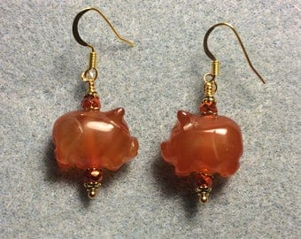 Orange carnelian gemstone pig bead earrings adorned with sparkly orange Chinese crystal beads.
