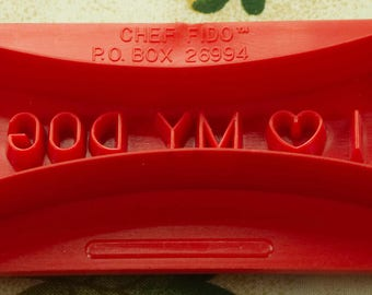 1990 2 Sided Red Plastic Dog Biscuit Cutter By Chef Fido