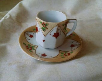 Japanese Lusterware Demitasse cup and saucer, Marked Japan