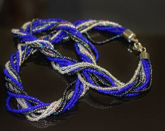 Hand Made Necklace Nine Strands Twisted Blue Clear and Rainbow Colour Seed Bead Black Rhino Design Special Occasion Evening Item Classic