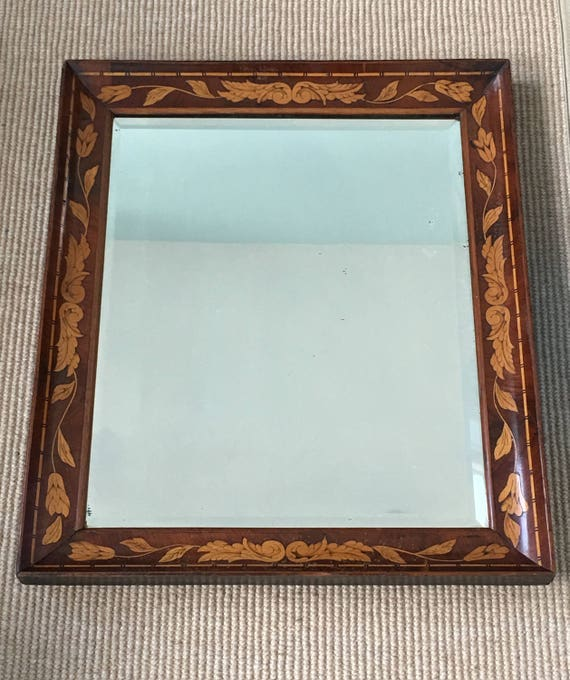 Early 18th century Dutch marquetry foliate mirror with bevelled glass