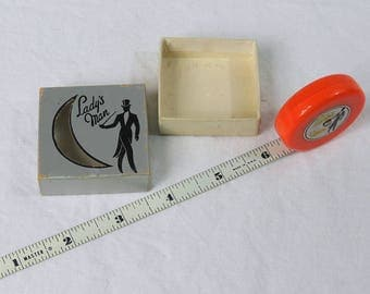 Art Deco Soft Orange Lady's Man Tape Measure - Excellent with Box