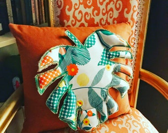 Orange and green Monstera deliciosa appliqué pocket pillow