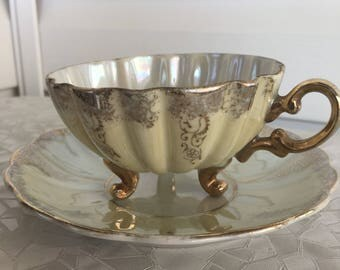 Vintage Shafford Japan footed tea cup and saucer, pale yellow and pearl lustre iridescent with gold gilt