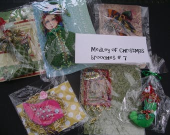 One medley of Christmas brooches