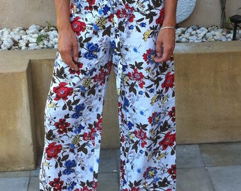 White cotton pyjamas with red and blue floral design, elasticated waist and drawstring - 'Oriental Red'