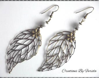 These filigree earrings bronze leaf with White Pearl