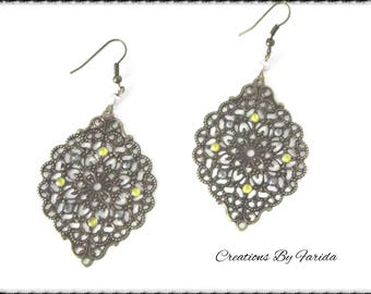 Earrings bronze pendant with a print and grey and yellow rhinestones