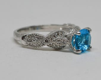 Gorgeous silver tone ring with blue stone
