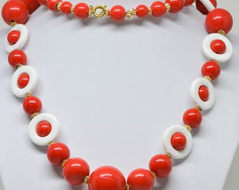 Red and white tone plastic beaded necklace