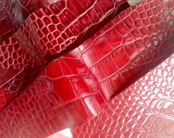 Strips of bright red crocodile embossed leather