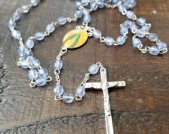 Blue vintage rosary...blessed mother center plate