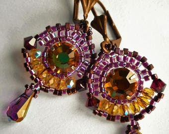 Earrings woven in colors Orange, purple and plum glass beads and Swarovski Crystal beads.