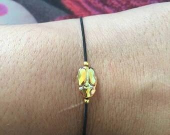 Scarab beetle Swarovski elastic black cord bracelet