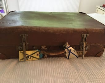 Large brown vintage suitcase with RAF labels