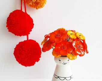 """""""Margot"""" Red and orange daisy bouquet with smiling lady vase 😊"""