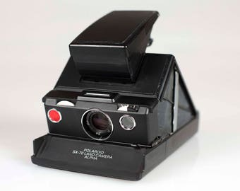 Polaroid land camera alpha SX-70 Black with Black skin - Fully working  - Vintage item from the 1970s working with Impossible project film