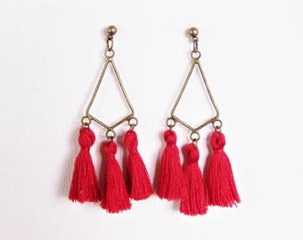 Red tassel and chandelier earrings
