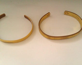 2 gold coloured open end bangles