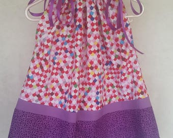 Pillowcase dress with satin ribbon ties.