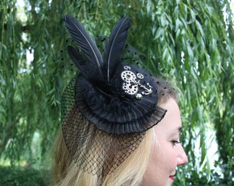 Black Fascinator with feathers, anchor, gears, a small veil, steampunk