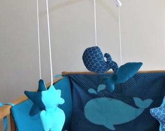 Musical mobile baby blue bed