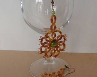 Tatting variation of Brown and green cat's eye bead earrings