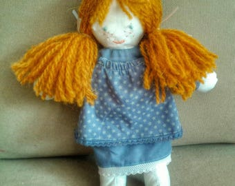Rag doll in dress and petticoat