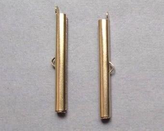 tube 40 mm gold tone cuff 2 caps